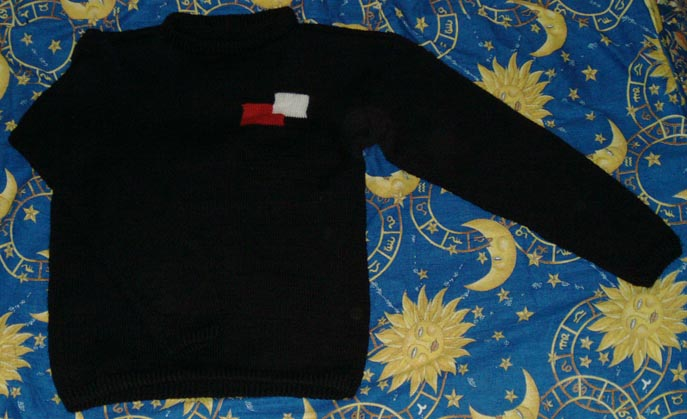 вязаный свитер с толстой вязкой.